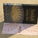 A portable stereographic sundial on the end-flap of a book