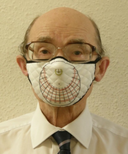 A portable stereographic sundial printed on a face mask